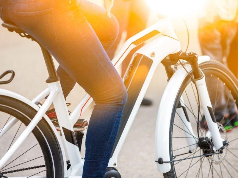 person riding a white electric bike